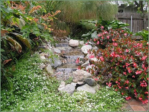 Pondless waterfall designed and installed by EnviroscapeLA Manhattan Beach California